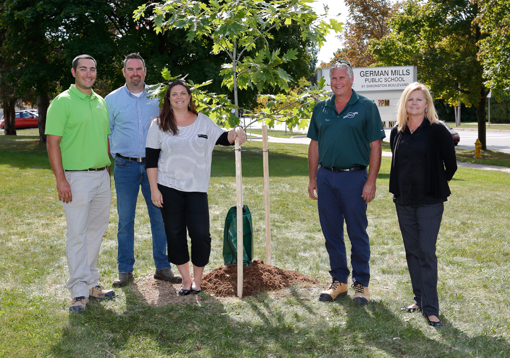Some members of Head Office with the Principal of German Mills P.S. with the newly planted tree